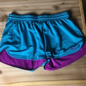Nike running shorts small.  Teal and purple